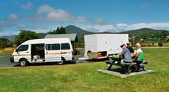 support vehicle of Green Island Tours with its purpose build trailer at a lunchbreak in Zeehan